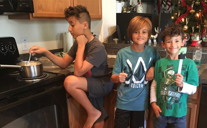 Three boys helping me make 7-Up Salad in the kitchen.