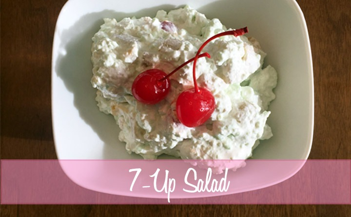 7-Up Salad with lime jello and marshmallows topped with red cherries.