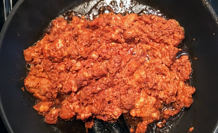 Fresh ground Mexican chorizo removed from casing in a skillet.