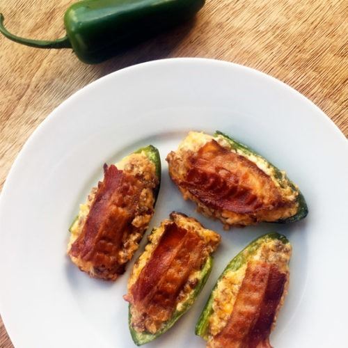 Maple Sausage Cream Cheese Jalapeno Poppers with bacon on a white plate.