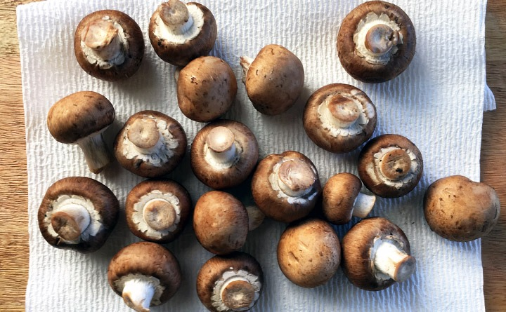 Clean mushrooms with a damp towel or rinse quickly and dry.