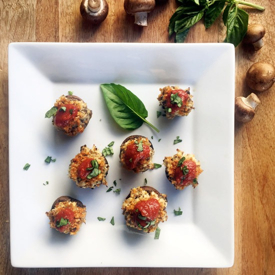 Chicken Parmesan Stuffed Mushrooms with tomato sauce and basil