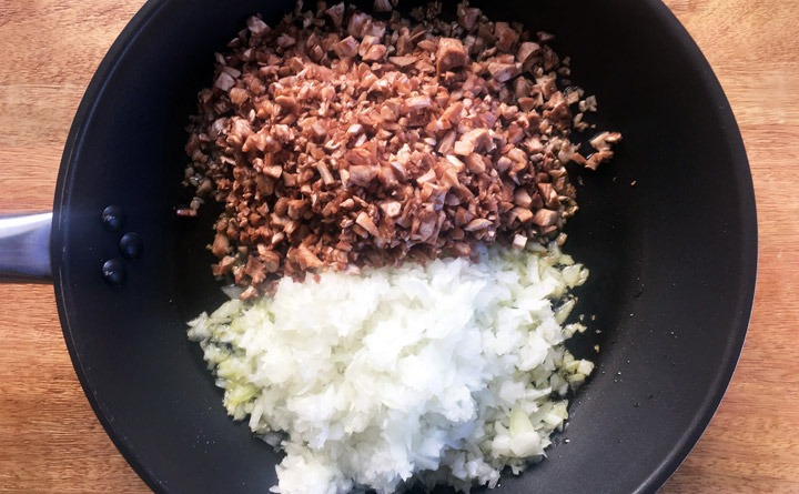 Saute finely diced onions and mushroom stems in olive oil.