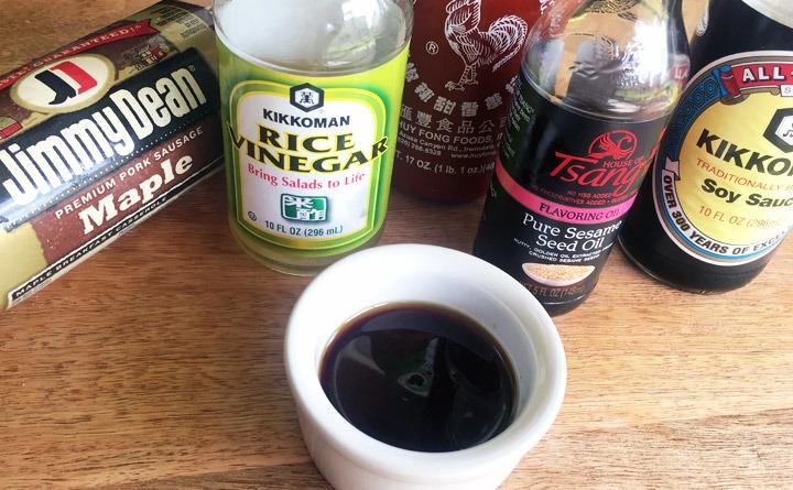 Mix soy sauce, rice wine vinegar, sesame oil and Sriracha hot chili sauce.