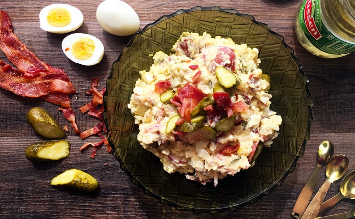 Dill pickle red potato salad with bacon and eggs.