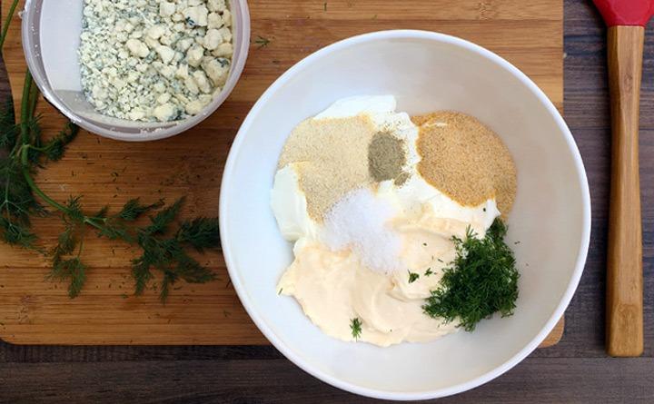 Mix together sour cream, mayonnaise, onion powder, garlic powder, dill, salt, and white pepper.
