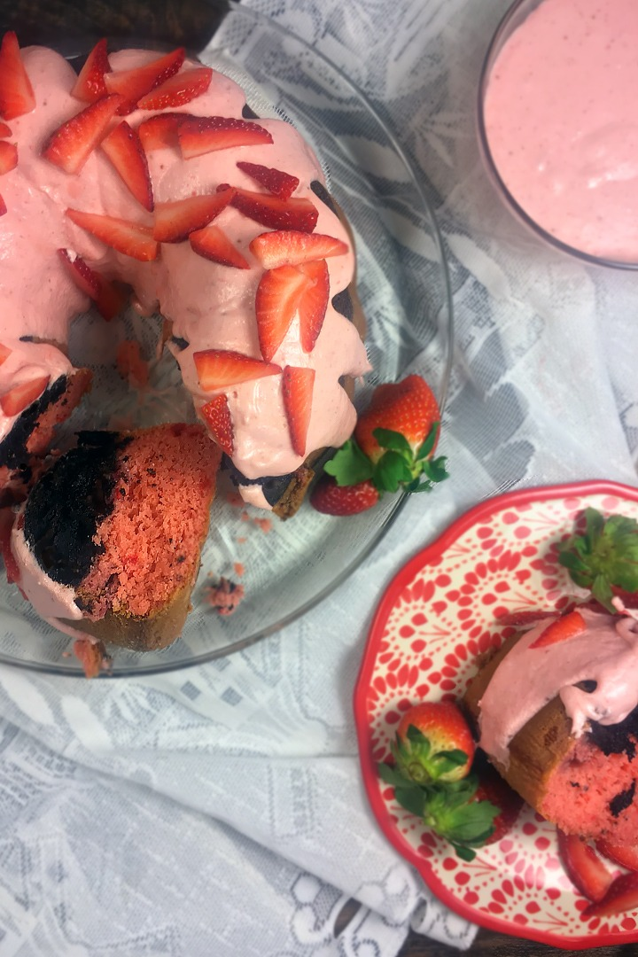 Dark chocolate brownie and strawberry cake with strawberry cream cheese icing.